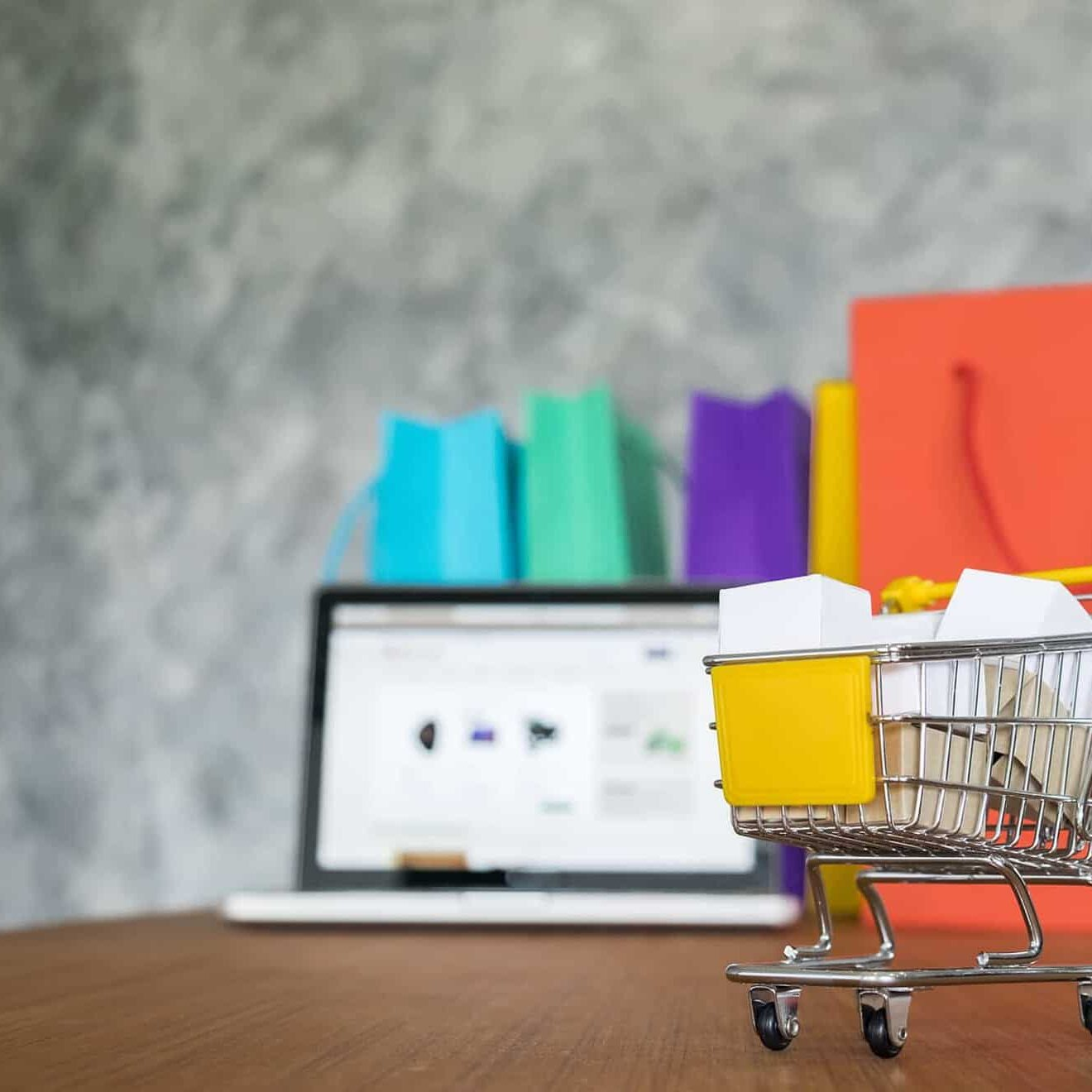 laptop and shopping bags, online shopping concept.